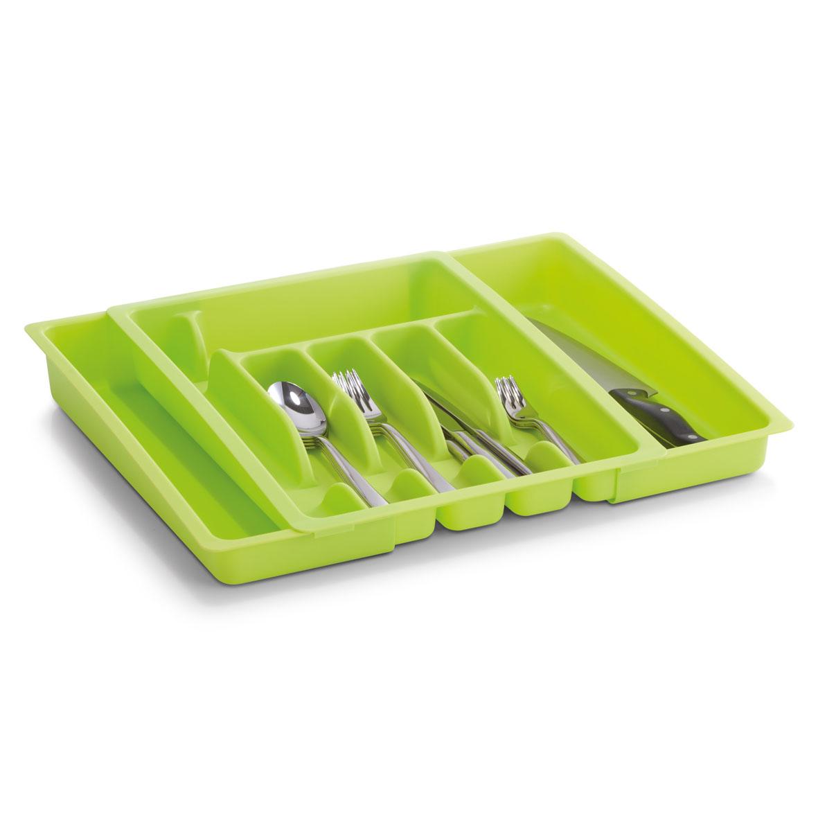 Подставка для столовых приборов Zeller, раздвижная, цвет: зеленый, 28-48 х 38 х 6,5 см24884Подставка для столовых приборов Zeller изготовлена из высококачественного прочного пластика. Изделие имеет 4 средних секции для хранения ложек, вилок и ножей, маленькую широкую и длинную узкую секции - для различных кухонных принадлежностей. Подставка регулируется по длине, что позволяет установить ее в любые кухонные ящики, при этом появляется дополнительная секция для хранения.