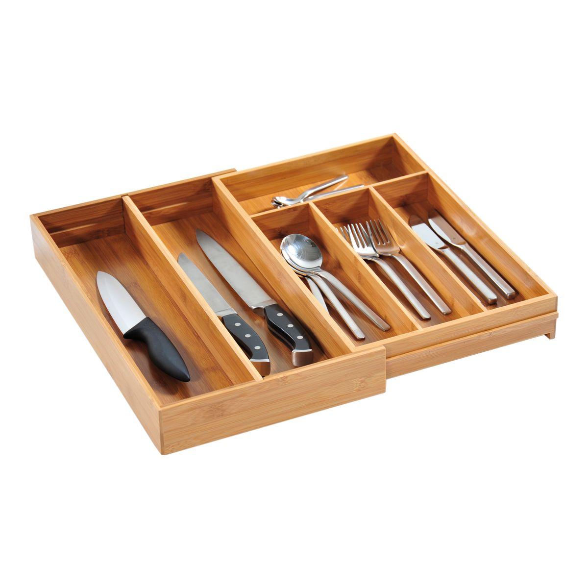 Подставка для столовых приборов Kesper, раздвижная, 26-49 см х 43 см х 6 см1718-6Подставка для столовых приборов Kesper изготовлена из высококачественного прочного дерева. Изделие имеет 3 секции для хранения столовых ложек, вилок и ножей и маленькую секцию - для чайных ложек. Подставка регулируется по длине, что позволяет установить ее в любые кухонные ящики, при этом появляются 2 дополнительные секции для хранения.