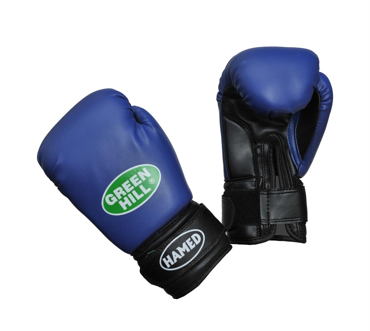 Перчатки боксерские детские Green Hill Hamed, цвет: синий. Вес 6 унцийBGHC-2022Детские боксерские перчатки Green Hill Hamed прекрасно подойдут для будущих чемпионов. Верх выполнен из искусственной кожи, наполнитель - из пенополиуретана. Перфорированная поверхность в области ладони позволяет создать максимально комфортный терморежим во время занятий. Широкий ремень, охватывая запястье, полностью оборачивается вокруг манжеты, благодаря чему создается дополнительная защита лучезапястного сустава от травмирования. Перчатки прекрасно сидят на руке. Застежка на липучке способствует быстрому и удобному одеванию перчаток, плотно фиксирует перчатки на руке.Возраст: от 5 до 10 лет.