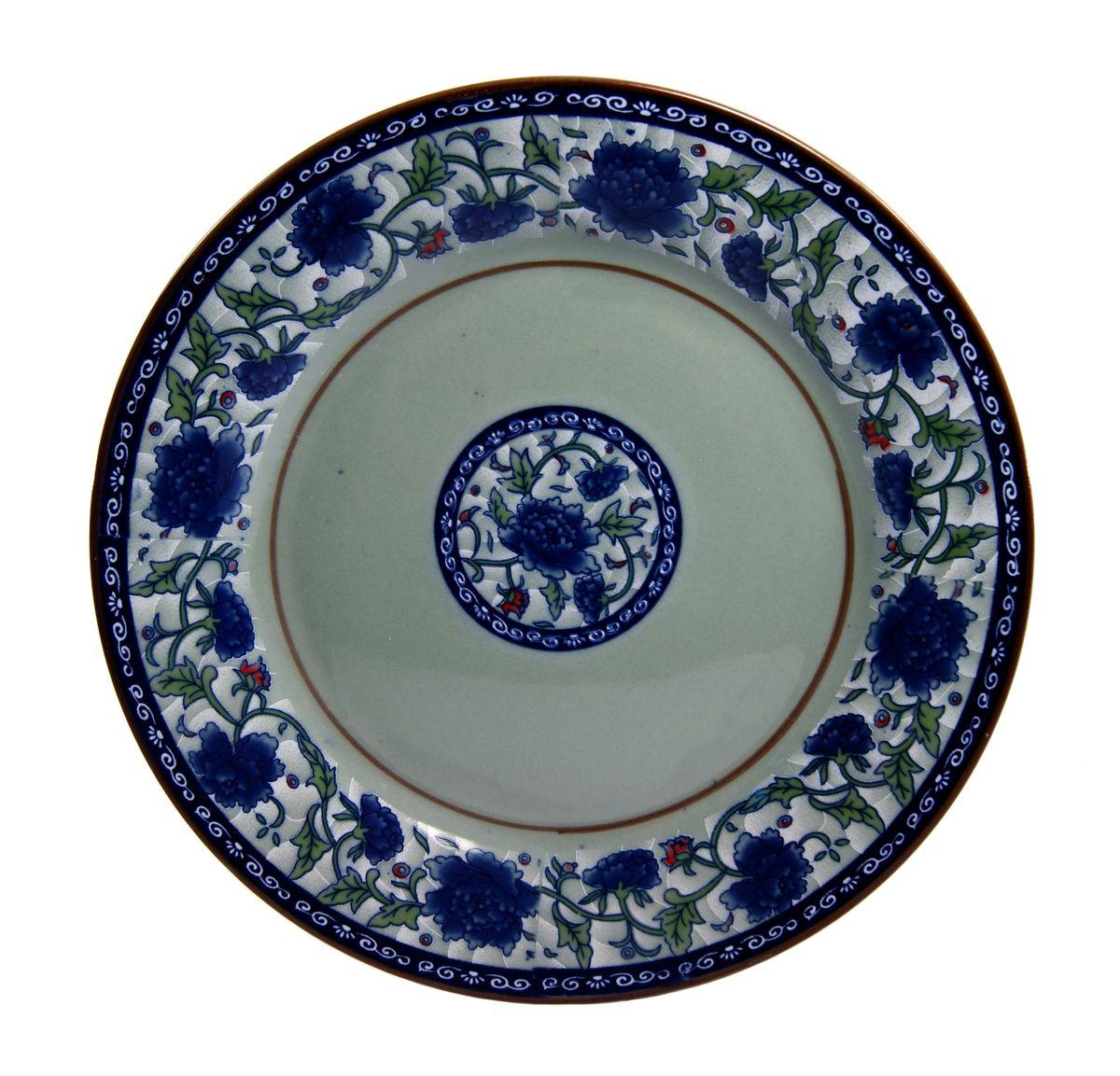 Тарелка для горячего Nanshan Porcelain Харбин, диаметр 25 смGNNSHB027Тарелка Nanshan Porcelain Харбин изготовлена из высококачественной керамики. Предназначена для красивой подачи различных блюд. Посуда безопасна для здоровья и окружающей среды. Внутренние стенки оформлены изящным узором. Такая тарелка украсит сервировку стола и подчеркнет прекрасный вкус хозяйки. Она дополнит коллекцию вашей кухонной посуды и будет служить долгие годы. Можно мыть в посудомоечной машине и использовать в СВЧ. Диаметр: 25 см.Высота: 2 см.