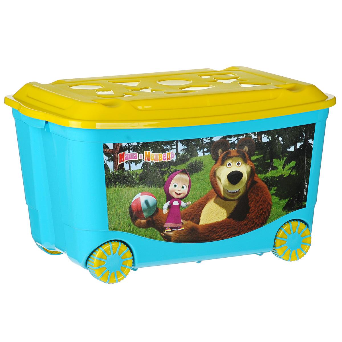 Ящик для игрушек Пластишка Маша и Медведь, на колесах, цвет: голубой, желтый, 58 см х 39 см х 33,5 смС13794 (4313794)Ящик Пластишка Маша и Медведь, выполненный из высококачественного пластика, предназначен для хранения детских игрушек. Ящик оснащен прорезиненными колесами, удобными ручками для переноски и специальными отверстиями, через которые можно продеть тесьму или веревку, чтобы ребенок мог легко передвигать его. Крышка ящика декорирована геометрическими фигурами. Конструкция замков позволяет фиксировать крышку, что препятствует попаданию пыли, влаги, насекомых.