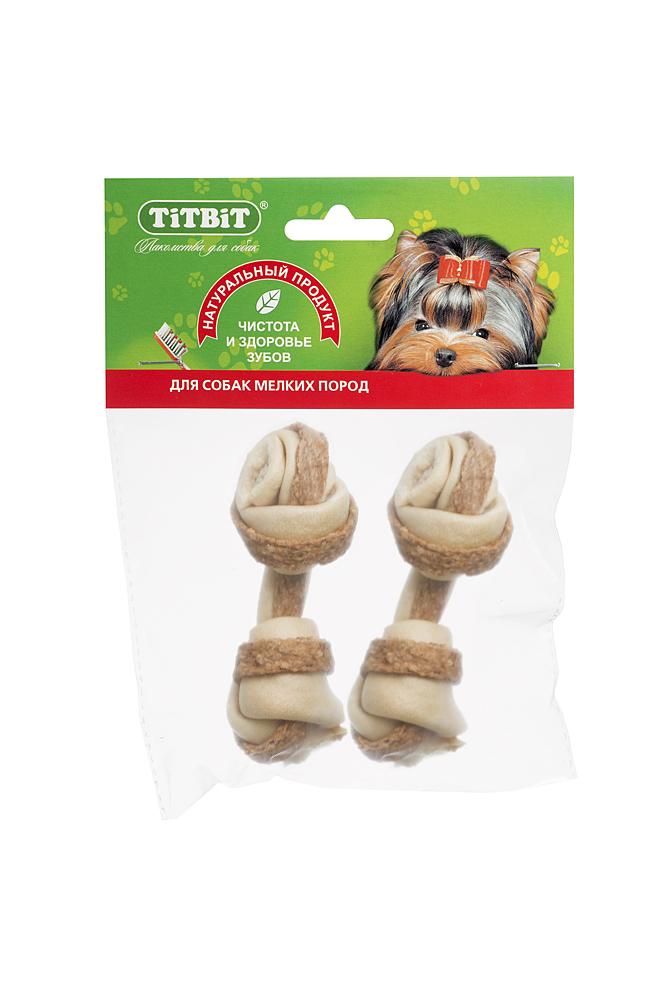 Лакомство для собакTitbit, кость узловая №2, с мясом курицы, 2 шт3237Высушенная говяжья кожа, свернутая в форме кости размером 90-110 мм с прослойкой начинки из мяса курицы. В упаковке 2 штуки.Благодаря большому содержанию аминокислот и коллагена положительно воздействует на состояние кожи и шерсти собаки, а такжеобеспечивает поступление в организм незаменимых компонентов для роста и поддержания качества хрящевой ткани суставов собак. Начинка из куриного мяса богата ценными пищевыми ферментами, каротином, биотином и витаминами А, Е, С, В6, В12. Содержит в достаточном количестве такие полезные минеральные вещества, как фосфор, железо, медь и цинк. Состав: Высушенная говяжья кожа, мясные субпродукты.