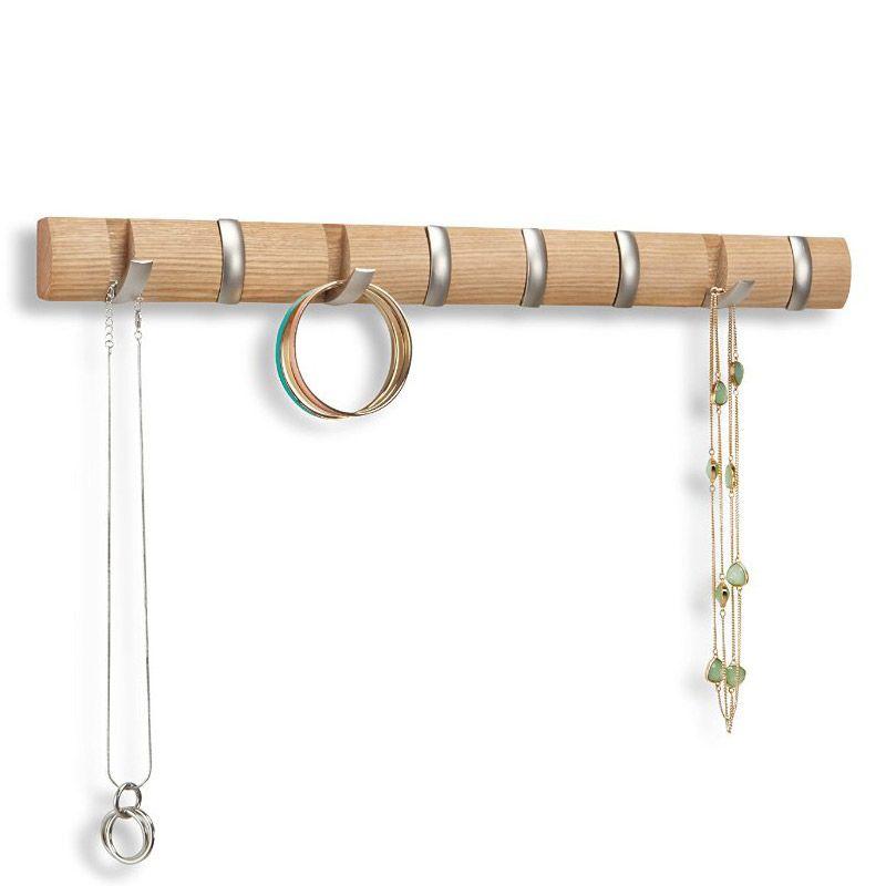 Вешалка Umbra Flip Мини, цвет: бежевый, 8 крючков318863-390Стильная и прочная вешалка Umbra Flip интересной формы и оригинального дизайна изготовлена из дерева. Имеет 8 откидных крючков из никеля: когда они не используются, то складываются, превращая конструкцию в абсолютно гладкую поверхность. Вешалка Umbra Flip идеально подходит для маленьких прихожих и ограниченных пространств. Каждый крючок выдерживает вес до 2,2 кг.