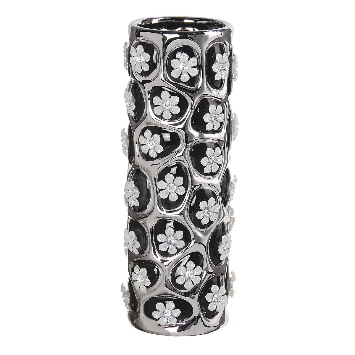 Ваза Цветочный орнамент, цвет: черный, белый, серебристый, 27 х 9 х 9 см. 866189866189Элегантная ваза Цветочный орнамент выполнена из высококачественной керамики. Изделие имеет рельефную поверхность, декорировано цветами. Оригинальный дизайн вазы придется по вкусу и ценителям классики, и тем, кто предпочитает утонченность и изящность. Вы можете поставить вазу в любом месте, где она будет удачно смотреться и радовать глаз. Такая ваза подойдет и для цветов, и для декора интерьера. Кроме того - это отличный вариант подарка для ваших близких и друзей.