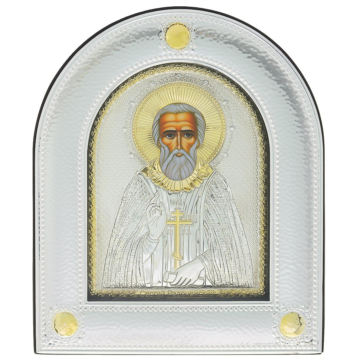 Икона Святого Сергия Радонежского, 30 см х 25,2 см743.ovxlns.dИкона Святого Сергия Радонежского - точная копия старинной Византийской иконы. Оклад изготовлен из алюминиевой основы с покрытием серебром 925 пробы толщиной 0,02-0,03 мм.Такое биметаллическое соединение обрабатывается по специальной технологии, при которой оно не темнеет со временем и устойчиво к механическим повреждениям. Само изображение ликов выполняется методом шелкографии. Также наносится золочение лаком на некоторые участки поверхности.Вся задняя часть иконы, а также по бокам, сверху и снизу отделана искусственной кожей, очень приятной на ощупь и с привлекательным запахом. У иконы имеется встроенная подставка. Также ее можно повесить. Икона под стеклом.Иконе Святого Сергия Радонежского молятся о защите от любых жизненных проблем, о защите детей от дурного влияния, от неудач в учебе. Молитвы перед иконой Святого Сергия Радонежского помогают в обретении смирения и терпимости, в укрощении гордыни. Дни празднования - 18 июля, 19 июля, 8 октября.