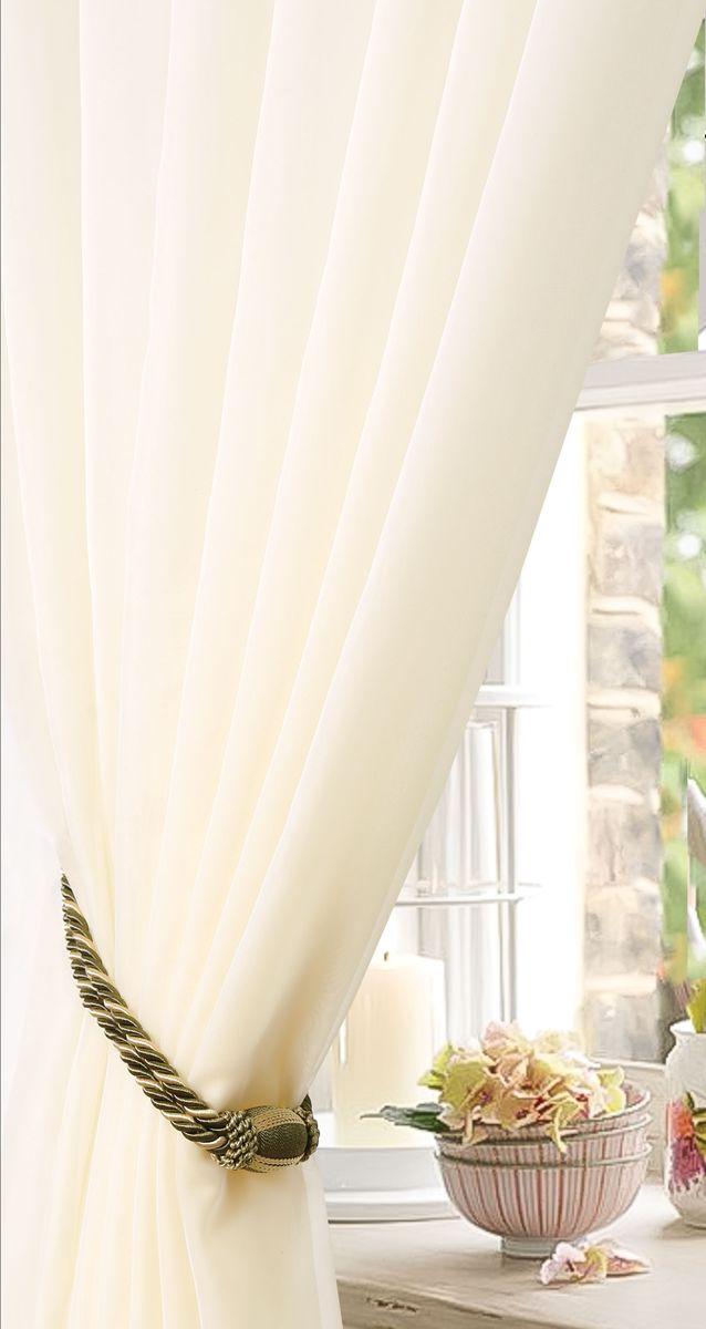 Штора готовая для гостиной Garden, на ленте, цвет: молочный, размер 175х260 см. с w191 v71002с w191 v71002Изящная тюлевая штора Garden выполнена из вуали (100% полиэстера). Полупрозрачная ткань, приятный цвет привлекут к себе внимание и органично впишутся в интерьер помещения. Такая штора идеально подходит для солнечных комнат. Мягко рассеивая прямые лучи, она хорошо пропускает дневной свет и защищает от посторонних глаз. Отличное решение для многослойного оформления окон. Штора Garden крепится на карниз при помощи ленты, которая поможет красиво и равномерно задрапировать верх.
