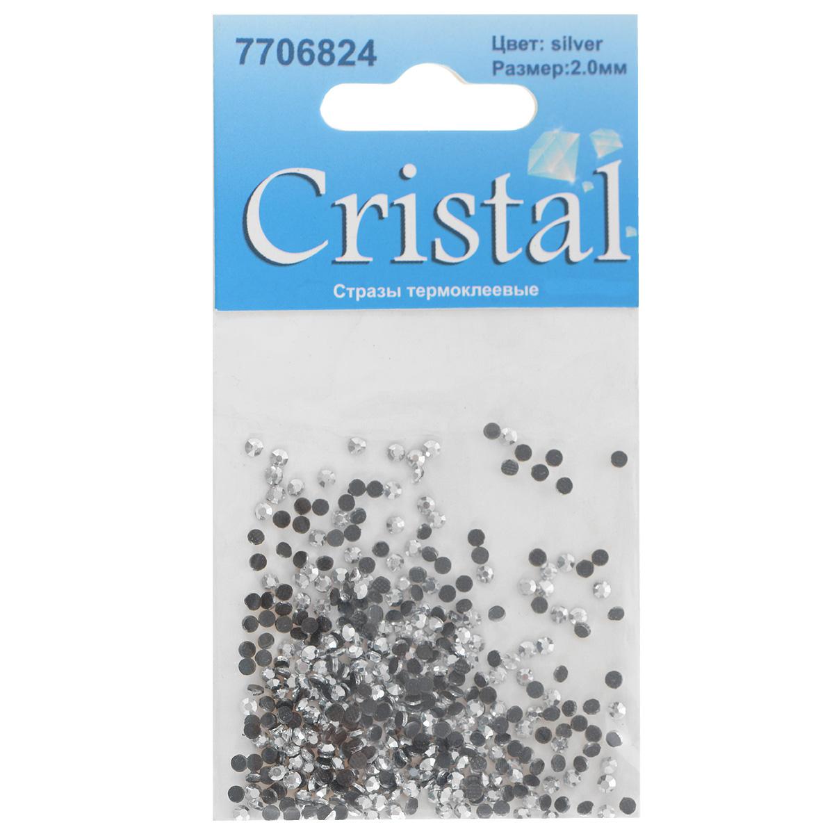 Стразы термоклеевые Cristal, цвет: серебристый, диаметр 2 мм, 432 шт7706824_сереброНабор термоклеевых страз Cristal, изготовленный из высококачественного акрила, позволит вам украсить одежду, аксессуары или текстиль. Яркие стразы имеют плоское дно и круглую поверхность с гранями.Дно термоклеевых страз уже обработано особым клеем, который под воздействием высоких температур начинает плавиться, приклеиваясь, таким образом, к требуемой поверхности. Чаще всего их используют в текстильной промышленности: стразы прикладывают к ткани и проглаживают утюгом с обратной стороны. Также можно использовать специальный паяльник. Украшение стразами поможет сделать любую вещь оригинальной и неповторимой. Диаметр страз: 2 мм.