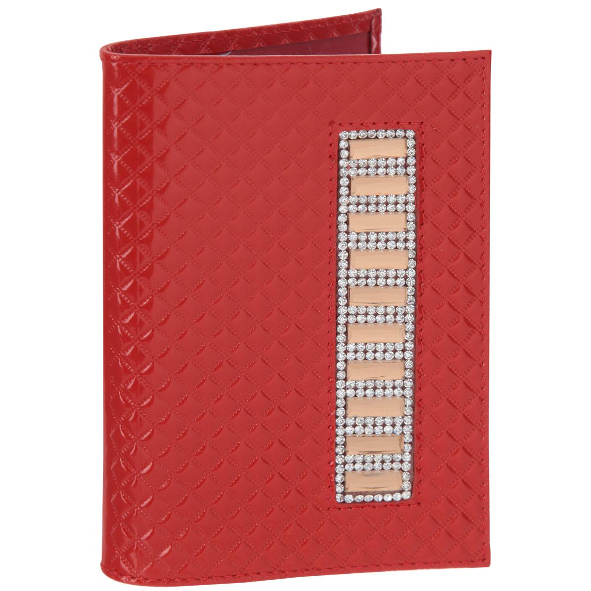 Обложка для паспорта женская Dimanche Shine, цвет: красный. 554Натуральная кожаОбложка для паспорта Dimanche Shine выполнена из натуральной кожи, декорирована фактурным тиснением и полоской из крупных и мелких страз. В изготовлении этого изделия использованы высококачественные стразы. Они были изготовлены в Египте, а идеальную форму и блеск им придали в Италии. Обложка на подкладке с пластиковыми клапанами. Обложка не только поможет сохранить внешний вид ваших документов и защитить их от повреждений, но и станет стильным аксессуаром, идеально подходящим вашему образу.Обложка для паспорта стильного дизайна может быть достойным и оригинальным подарком.