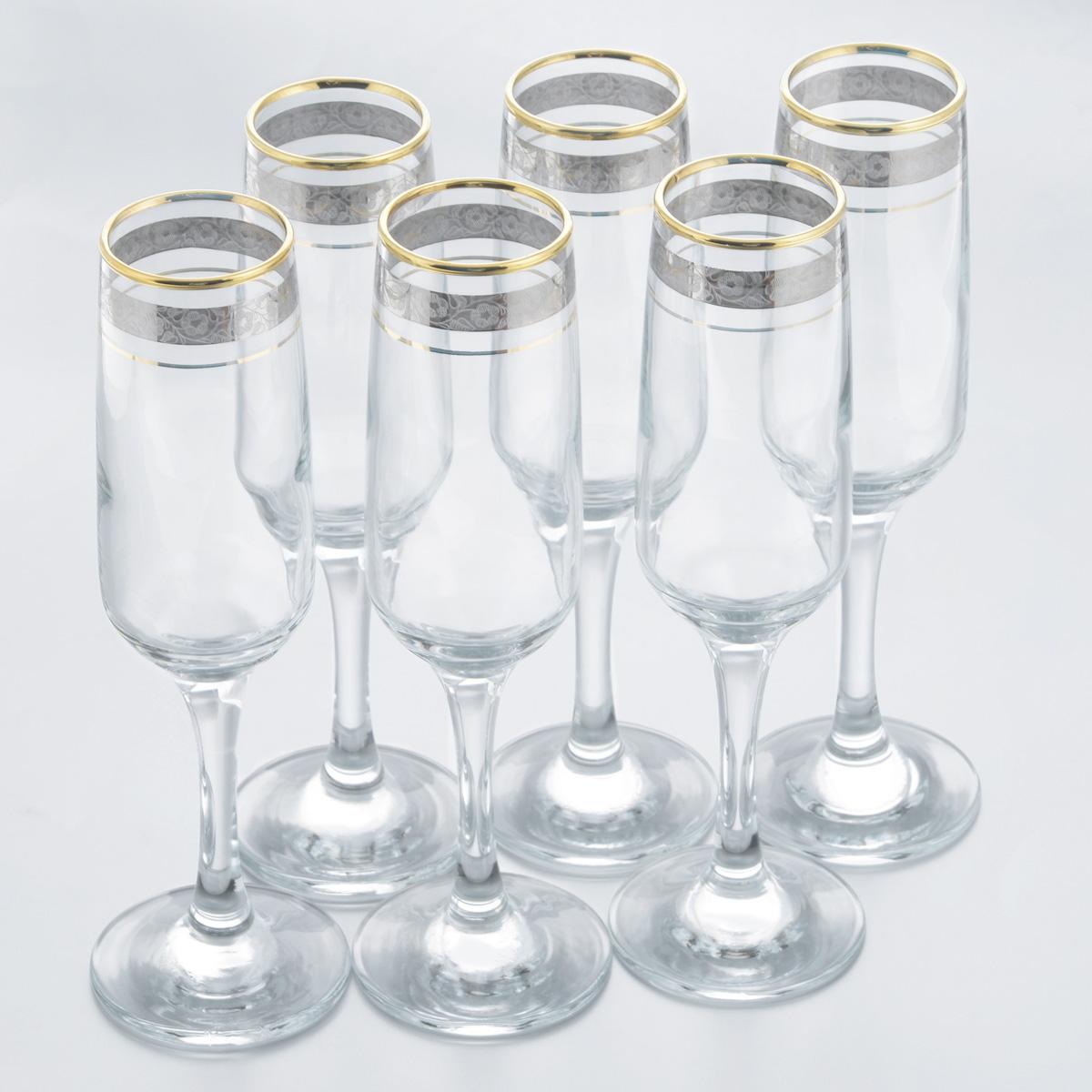 Набор бокалов Гусь Хрустальный Изабелла. Флорис, 250 мл, 6 штTL32-4170Набор Гусь Хрустальный Изабелла. Флорис состоит из шести бокалов, выполненных из прочного натрий-кальций-силикатного стекла. Изящные бокалы на высоких ножках, декорированные золотистым орнаментом и окантовкой, прекрасно подойдут для подачи шампанского или вина. Бокалы излучают приятный блеск и издают мелодичный звон, сочетают в себе элегантный дизайн и функциональность. Набор бокалов Гусь Хрустальный Изабелла. Флориспрекрасно оформит праздничный стол и создаст приятную атмосферу за романтическим ужином. Такой набор также станет хорошим подарком к любому случаю. Можно мыть в посудомоечной машине или вручную с использованием моющих средств, не содержащих абразивных материалов.Диаметр бокала (по верхнему краю): 4,5 см. Высота бокала: 22 см. Диаметр основания: 7 см.