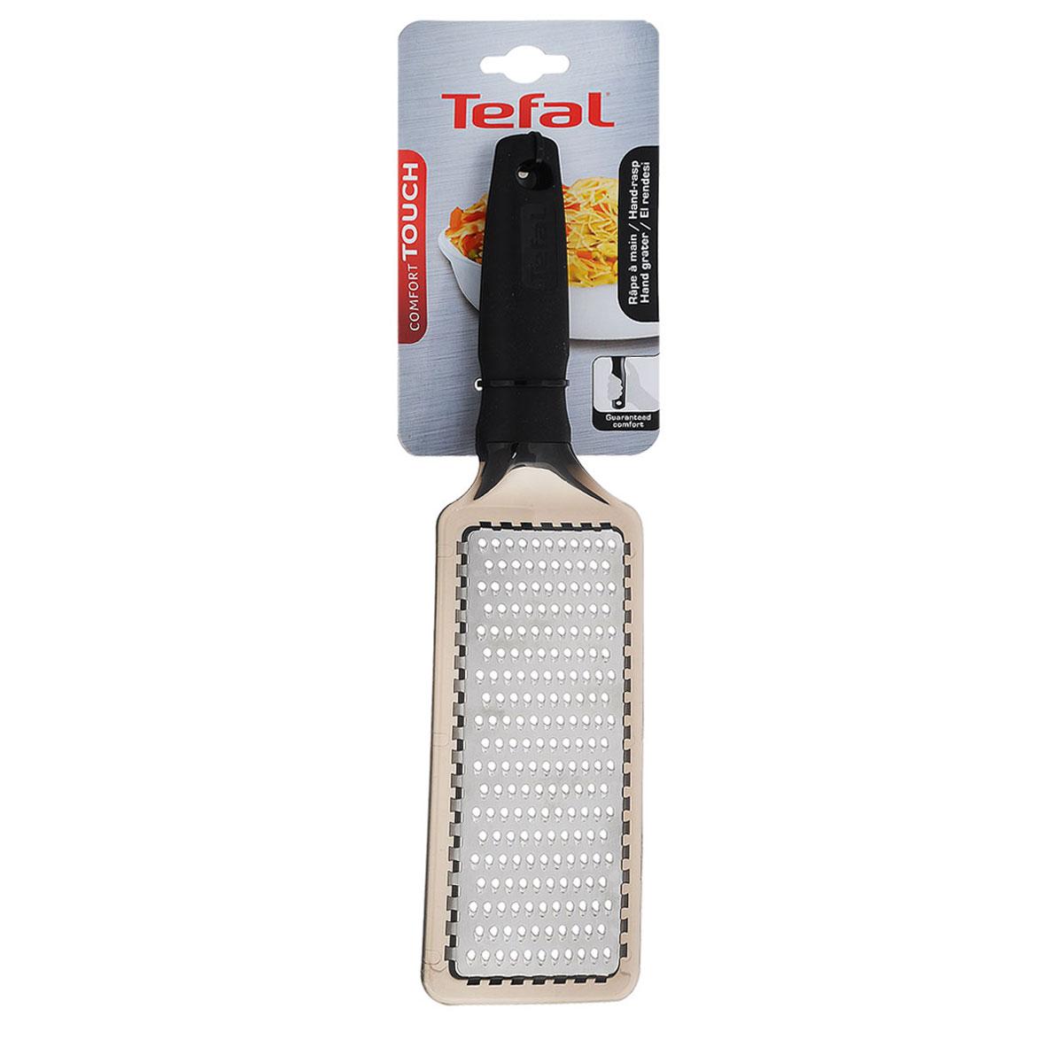 Терка Tefal Comfort Touch, плоская, с ручкой, цвет: черный2100071034Терка Tefal Comfort Touch изготовлена из высококачественной нержавеющей стали. Изделие снабжено лезвиями для мелкой терки. Благодаря удобной пластиковой прорезиненной ручке терку удобно использовать и приятно держать в руках. На ручке имеется отверстие для подвешивания.Терка Tefal Comfort Touch прекрасно дополнит коллекцию ваших кухонных аксессуаров.Общая длина терки: 29 см.