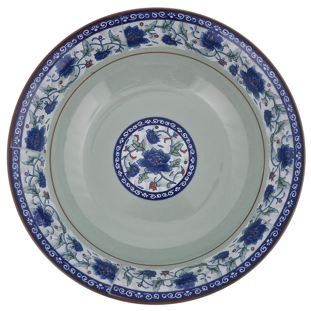 Салатница Nanshan Porcelain Харбин, цвет: зеленый, синий, диаметр 20 смGNNSHB009_рисунок внутриСалатница Nanshan Porcelain Харбин изготовлена из керамики. Посуда безопасна для здоровья и окружающей среды. Внутренние стенки оформлены изящным узором. Такая салатница прекрасно подходит для подачи холодных и горячих блюд: каш, хлопьев, супов, салатов. Она дополнит коллекцию вашей кухонной посуды и будет служить долгие годы. Можно использовать в посудомоечной машине и СВЧ. Диаметр салатницы (по верхнему краю): 20 см. Высота стенки салатницы: 5,5 см.