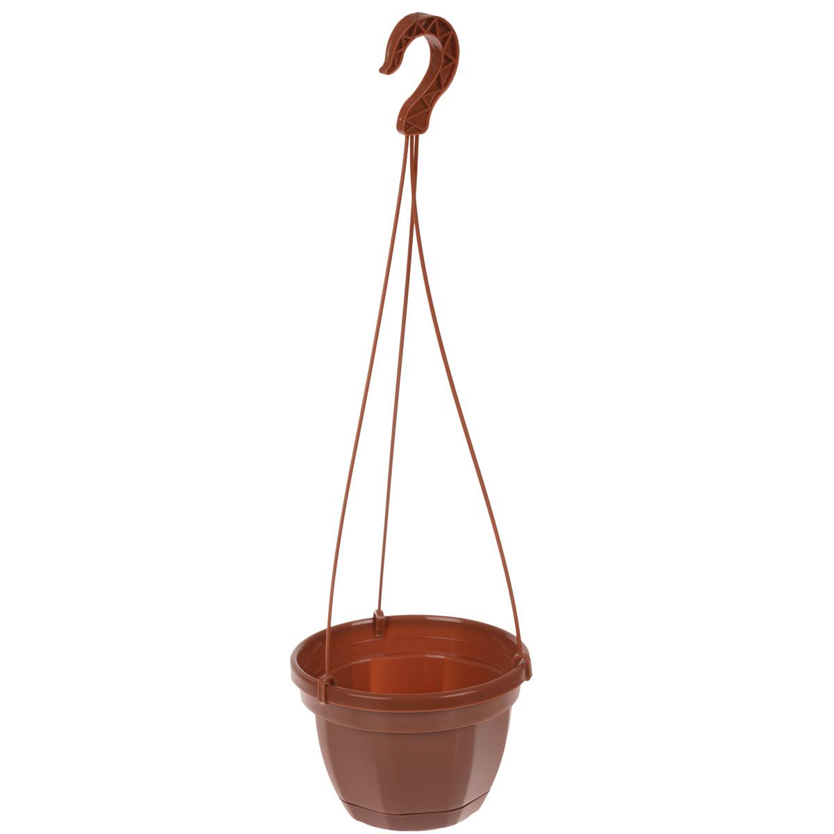 Кашпо на подвесе Инстар Ника, с поддоном, цвет: терракотовый, диаметр 17 смст071тер (ст089)Кашпо на подвесе Инстар Ника изготовлено из прочного пластика. Снабжено поддоном для стока воды. Изделие прекрасно подходит для выращивания рассады, растений и цветов в домашних условиях. Специальный подвес для крепления к стене. Стильный лаконичный дизайн впишется в интерьер любого помещения. Диаметр кашпо (по верхнему краю): 17 см. Высота кашпо: 12 см. Высота кашпо (с подвесом): 51 см.