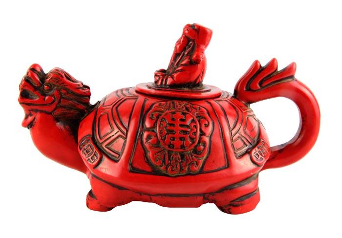 """Чайник в тибетском стиле """"Драконочерепаха"""". Искусственный камень, резьба. Китай, вторая половина XX века. Высота 9,5 см, длина 18 см, ширина 11 см. На дне иероглифическое клеймо. Сохранность хорошая.На Востоке особое значение имеют форма и цвет чайников и чайных сервизов. Ярко-красный чайник выполнен в виде мифического дракона-черепахи, украшен резьбой.Оригинальный чайник в тибетском стиле станет прекрасным подарком любителям Востока и ярким элементом декора. Прекрасный образец декоративно-прикладного искусства Тибета, оригинальный подарок почитателю буддийской культуры."""