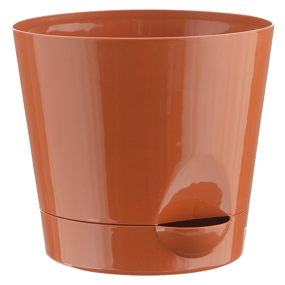Кашпо Idea Ника, с прикорневым поливом, с поддоном, цвет: терракотовый, 800 мл67063_1Кашпо Idea Ника изготовлено из высококачественного полипропилена (пластика). В комплект входит поддон со специальной выемкой, благодаря которому имеется возможность прикорневого полива. Изделие подходит для выращивания растений и цветов в домашних условиях. Стильная яркая картинка сделает такое кашпо прекрасным дополнением интерьера.Объем горшка: 0,8 л.Диаметр горшка (по верхнему краю): 12 см.Высота горшка: 10,7 см.Диаметр подставки: 10 см.