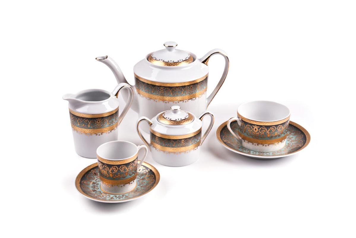 Сервиз чайный Tunise Porcelaine, 15пр, цвет: бело-зеленый с золотом539509 1643Чайник 1,2л, сахарница 250мл, молочник 300мл, чайная пара 220 мл *6 штук . Фарфор фабрики Tunisie Porcelaine, производится в Тунисе из знаменитой своим качеством и белизной глины, добываемой во французской провинции Лимож.Преимущества этого фарфора заключаются в устойчивости к сколам и трещинам, что возможно благодаря двойному термическому обжигу. Европейский дизайн, декор и формы обеспечиваются за счет тесного сотрудничества фабрики с ведущими мировыми дизайн-бюро такими как: Nelly Reynal, Yves De la Rosiere, Sarah Anderson, Heracles. Материал: фарфор: цвет: бело-зеленый с золотомСерия: MIMOSA