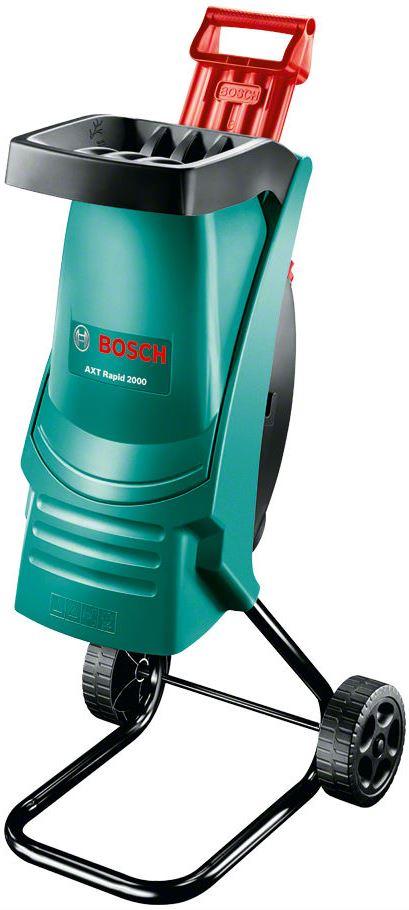 Садовый измельчитель мусора Bosch AXT 2000 RAPID - прекрасный помощник для наведения порядка на участке. Листья, сучки, остатки корней  легко утилизируются, либо могут послужить в измельченном виде удобрением для грядок. Данную модель отличает современный дизайн воронки  со встроенным толкателем, заметно увеличивающие скорость работы.  Садовый измельчитель AXT Rapid 2000 отличается компактностью и производительностью. Оснащенный режущей системой ножевых  измельчителей, он способен обрабатывать до 80 кг веток в час. Высококачественные лезвия - долговечные, изготовленные по лазерной  технологии точные ножи с высокой производительностью резки. Отлично подходит для обработки мягкого садового материала. Малый вес,  удобная ручка и колесики делают AXT Rapid 2000 маневренным и мобильным.   Режущая система ножевых измельчителей  Долговечный, изготовленный по лазерной технологии точный нож с высокой производительностью резки.   Высокая производительность  Быстродействующая воронка и практичный толкатель для простого заполнения и высокой производительности измельчения.   Мобильный  Высокая маневренность благодаря малому весу и удобным колесикам.