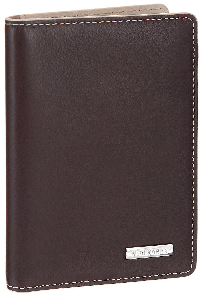 Обложка для автодокументов Neri Karra, цвет: коричневый, бежевый. 0132 3-01.49/330132 3-01.49/33Стильная обложка для автодокументов Neri Karra выполнена из натуральной высококачественной кожи и декорирована прострочкой по контуру. Лицевая сторона обложки оформлена металлической пластиной с названием бренда.Модель содержит съемный блок из шести прозрачных файлов из мягкого пластика и два вертикальных кармана. В обложке помимо основных документов на автомобиль можно разместить 7 пластиковых карт, для этого предусмотрено 6 кармашков и сетчатое окошко.Изделие упаковано в стильную фирменную коробку.Обложка не только поможет сохранить внешний вид ваших документов и защитить их от повреждений, но и станет стильным аксессуаром, который подчеркнет ваш неповторимый стиль.