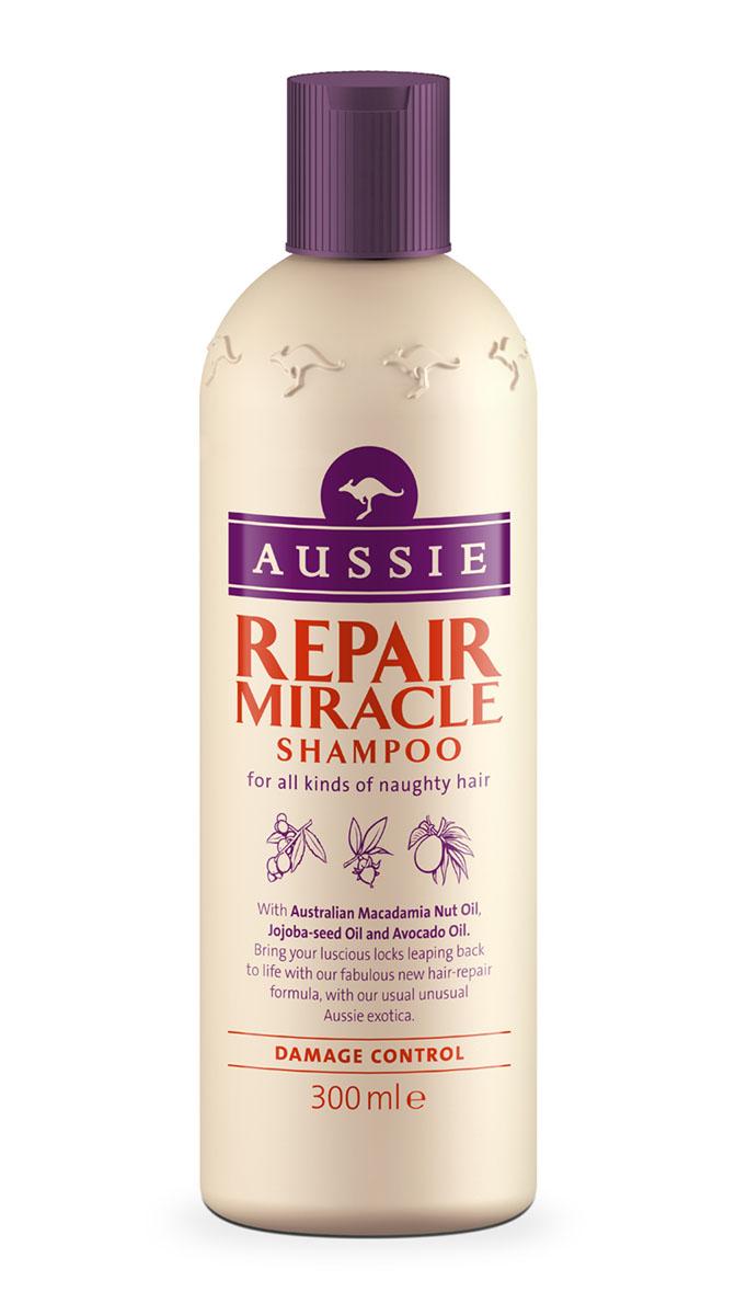 Aussie Шампунь Repair Miracle, для поврежденных волос, 300 млAUS-81520800Красивые волосы - это не все, что тебе нужно для счастья, но с них можно начать. Философия Aussie.Для всех типов непослушных волос.Наша специальная формула с маслами австралийского ореха макадамия, семян жожоба и авокадо превратит сухие поврежденные волосы в послушные блестящие локоны.