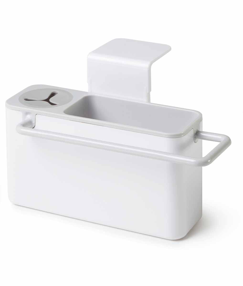 """Подставка для кухонных принадлежностей  Идея """"Mr. Чистюля"""" поможет навести на кухне полный порядок и расставить все по своим местам.  В ней найдется место для кухонной салфетки, моющего средства, ершика и губки. Подставка не только поможет вам держать под рукой необходимые для мытья посуды принадлежности, но и добавит настроения. Щетку можно поставить в отсек с силиконовым держателем, кухонную салфетку повесить на рейлинг, где она быстрей высохнет, а губку для мытья посуды положить внутрь подставки. Вся вода, которая будет собираться с моющих принадлежностей, будет стекать в раковину.  Подставка крепится на раковину мощными присосками, при необходимости она легко снимается, разбирается и моется. Размер подставки: 19 см х 9 см х 9 см."""
