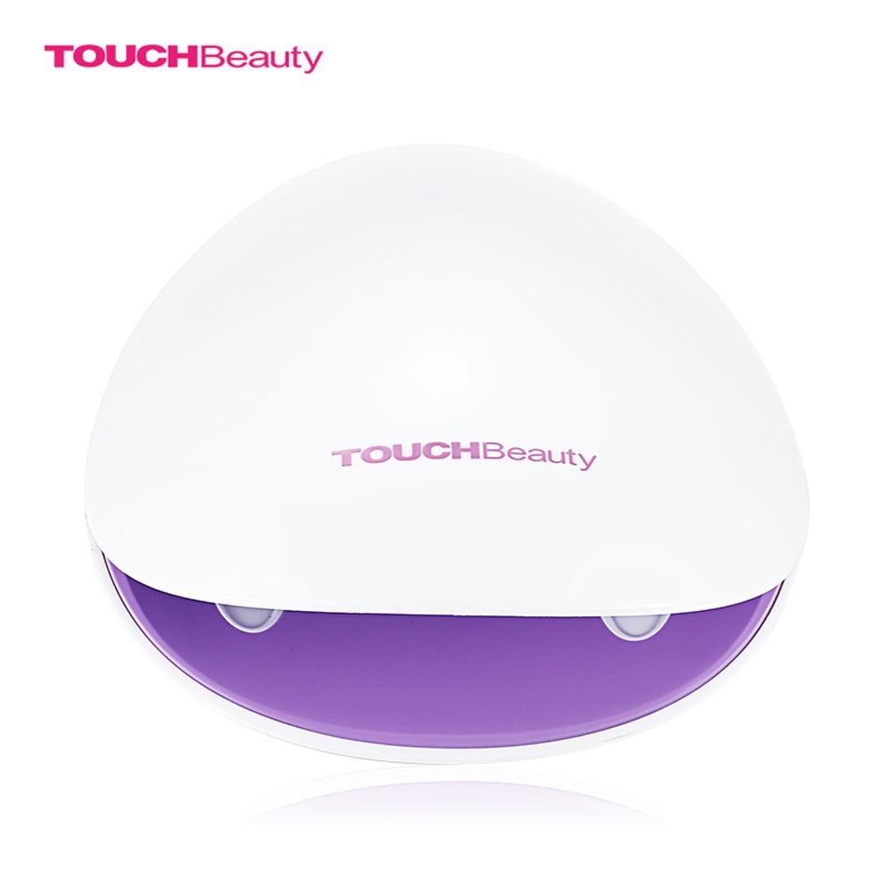 Сушка для ногтей Touchbeauty TB-1438TB-1438СУШКА ДЛЯ НОГТЕЙ. Ультрафиолетовый свет. Высушивает лак за 2 минуты. Автоматическое включение при поднесении руки – экономично и легко. Лампа подходит как для сушки обычного лака, так и для всех видов гель-лака и шеллака. Компактный размер. Ультрасовременный изумительный дизайн. Питание: 2 батарейки ААА.