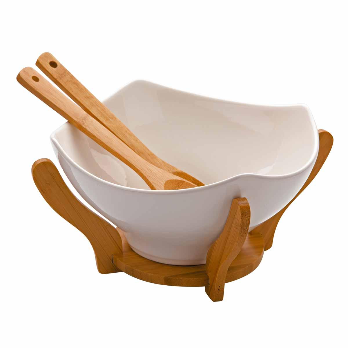 Салатница Dekok, с 2 ложками, с подставкой, 23,5 х 23,5 смPW-2711Салатница Dekok изготовлена из фарфора и имеет оригинальную форму. Посуда безопасна для здоровья и окружающей среды. Изделие размещено на подставке, выполненной из бамбука. Такая салатница прекрасно подходит для различных блюд: каш, хлопьев, салатов и многого другого. Она дополнит коллекцию вашей кухонной посуды и будет служить долгие годы. В наборе - 2 деревянные сервировочные ложки.Размер салатницы (по верхнему краю): 23,5 см х 23,5 см. Высота стенки салатницы: 12 см.Длина ложек: 26 см.Размер рабочей части ложек: 6 см х 8,5 см.Размер подставки: 21 см х 21 см х 11,6 см.