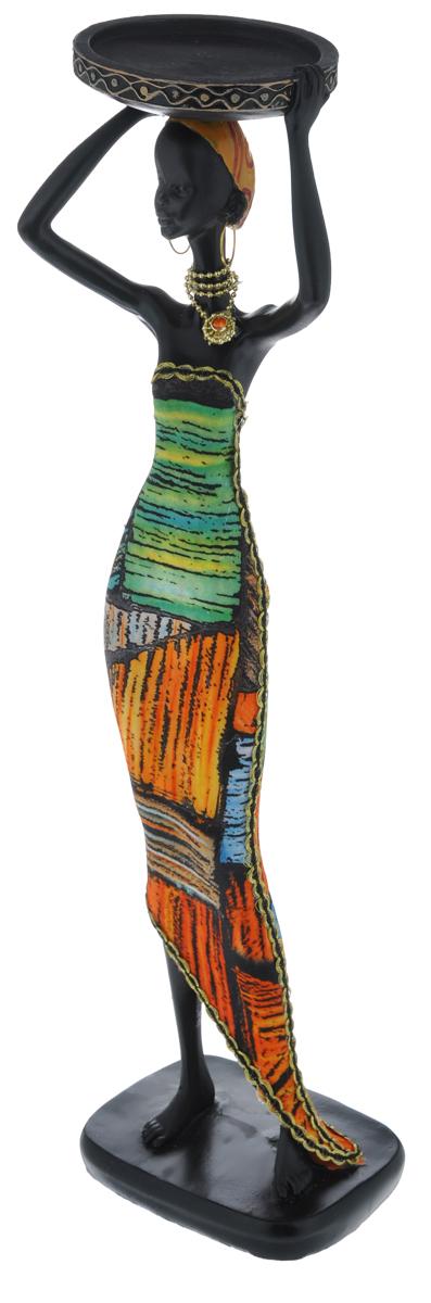 Декоративная фигурка Феникс-презент Африканка с подносом, высота 37 см37912Декоративная фигурка Африканка с подносом, изготовленная из полирезины, достойно украситинтерьер вашего дома или офиса. Она выполнена в виде африканской девушки в национальнойодежде с подносом на голове. Вы можете поставить украшение в любом месте, где оно будет удачно смотреться и радоватьглаз. Кроме того, это отличный вариант подарка для ваших близких и друзей.