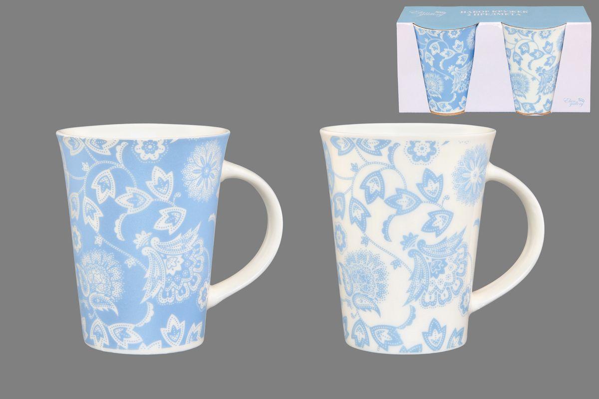 Набор кружек Elan Gallery Изящные цветы, цвет: белый, голубой, 320 мл, 2 шт250085Набор Elan Gallery Изящные цветы состоит из двух кружек, выполненных из керамики. Этот необычный набор станет великолепным подарком для каждого и, несомненно, вызовет восхищение.Объем кружек: 320 мл.Диаметр кружек (по верхнему краю): 8,5 см.Высота кружек: 11 см. Не рекомендуется применять абразивные моющие средства. Не использовать в микроволновой печи.