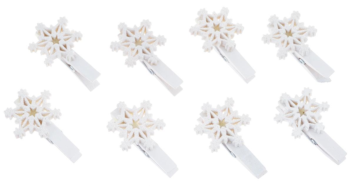 Набор декоративных прищепок Феникс-презент Снежинки большие, 8 шт38497Набор Феникс-презент Снежинки большие состоит из 8 декоративных прищепок, выполненных из дерева. Прищепки оформлены декоративными фигурками из полирезина в виде белых снежинок. Изделия используются для развешивания стикеров на веревке, маленьких игрушек, а оригинальность и веселые цвета прищепок будут радовать глаз и поднимут настроение.Размер прищепки: 4,5 см х 1,5 см х 3 см.