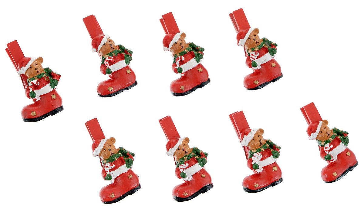 Набор декоративных прищепок Феникс-презент Мишка в носочке, 8 шт38483Набор Феникс-презент Мишка в носочке состоит из 8 декоративных прищепок, выполненных из дерева. Прищепки оформлены декоративными фигурками из полирезины в виде забавных мишек. Изделия используются для развешивания стикеров на веревке, маленьких игрушек, а оригинальность и веселые цвета прищепок будут радовать глаз и поднимут настроение.Размер прищепки: 4,5 см х 1,5 см х 2,5 см.
