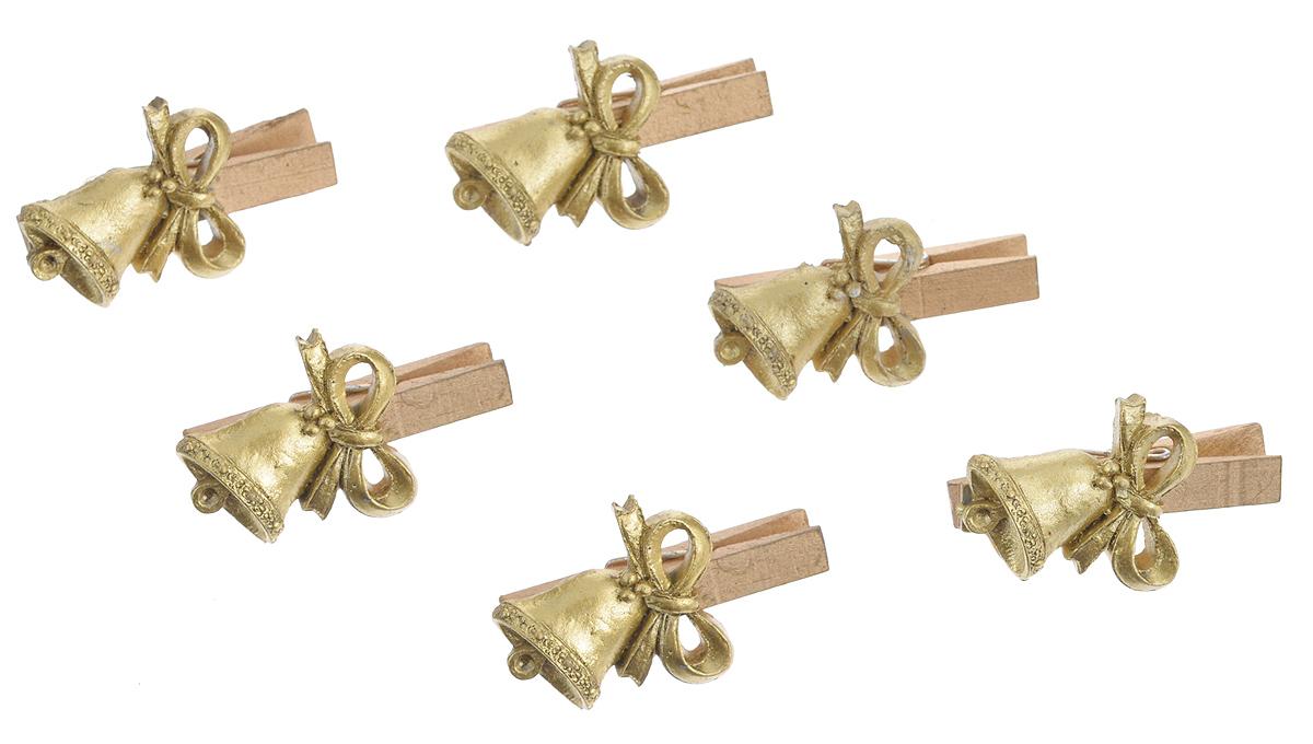 Набор декоративных прищепок Феникс-презент Золотые колокольчики, 6 шт38494Набор Феникс-презент Золотые колокольчики состоит из 8 декоративных прищепок, выполненных из дерева. Прищепки оформлены декоративными фигурками из полирезины. Изделия используются для развешивания стикеров на веревке, маленьких игрушек, а оригинальность и веселые цвета прищепок будут радовать глаз и поднимут настроение.Размер прищепки: 4,5 см х 1,5 см х 3 см.