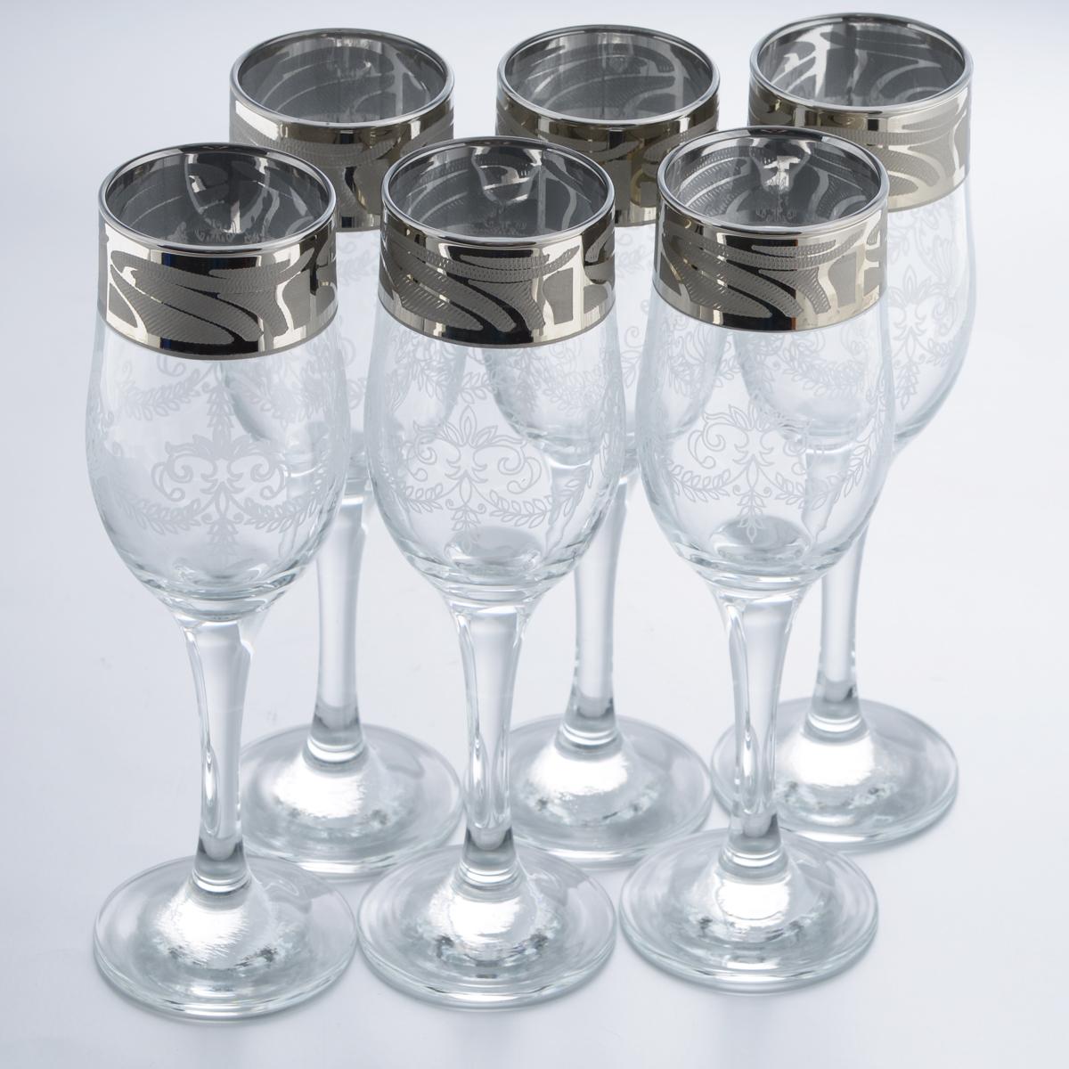 Набор бокалов Гусь-Хрустальный Мускат, 200 мл, 6 штGE05-160Набор Гусь-Хрустальный Мускат состоит из 6 бокалов на длинных тонких ножках, изготовленных из высококачественного натрий-кальций-силикатного стекла. Изделия оформлены красивым зеркальным покрытием и белым матовым орнаментом. Бокалы предназначены для шампанского или вина. Такой набор прекрасно дополнит праздничный стол и станет желанным подарком в любом доме. Разрешается мыть в посудомоечной машине. Диаметр бокала (по верхнему краю): 5 см. Высота бокала: 20 см.