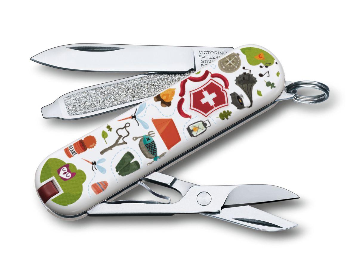 Нож-брелок Victorinox Classic Nature Adventure, цвет: белый, красный, зеленый, 7 функций, 5,8 см0.6223.L1505Лезвие складного ножа-брелока Victorinox Classic Nature Adventure изготовлено из высококачественной нержавеющей стали. Ручка, выполненная из прочного пластика, обеспечивает надежный и удобный хват. Нож имеет компактные размеры и не занимает много места.Хорошее качество, надежный долговечный материал и эргономичная рукоятка - что может быть удобнее на природе или на пикнике!В комплекте чехол, изготовленный из искусственной кожи.Функции ножа:Лезвие.Пилка для ногтей с отверткой.Ножницы.Кольцо для ключей.Пинцет.Зубочистка.Длина ножа в сложенном виде: 5,8 см.Длина ножа в разложенном виде: 9,8 см.