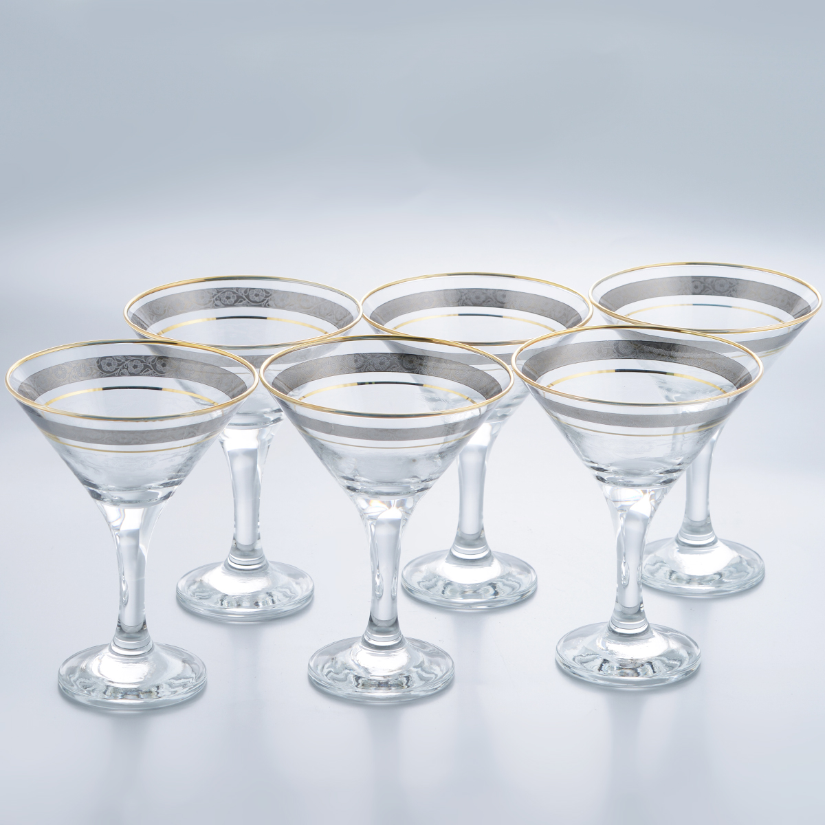 Набор бокалов для мартини Гусь-Хрустальный Нежность, 170 мл, 6 штTL34-410Набор Гусь-Хрустальный Нежность состоит из 6 бокалов на длинных ножках, изготовленных из высококачественного натрий-кальций-силикатного стекла. Изделия оформлены красивым зеркальным покрытием, оригинальной окантовкой с цветочным узором и прозрачным орнаментом. Бокалы предназначены для подачи мартини. Такой набор прекрасно дополнит праздничный стол и станет желанным подарком в любом доме. Разрешается мыть в посудомоечной машине. Диаметр бокала (по верхнему краю): 10,5 см. Высота бокала: 13,5 см. Диаметр основания бокала: 6,3 см.