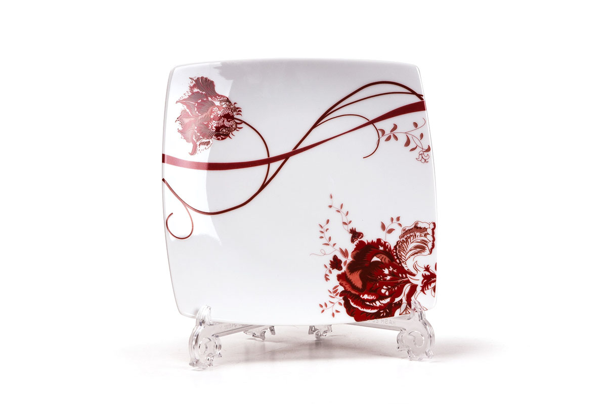 Набор тарелок Yves De La Rosiere Kyoto, 20 см х 20 см, 6 шт719101 0753Набор Yves De La Rosiere Kyoto состоит из шести тарелок, оформленных цветочным рисунком. Предметы набора изготовлены из высококачественного фарфора. Изящный дизайн придется по вкусу и ценителям классики, и тем, ктопредпочитает утонченность и изысканность. Он настроит на праздничный лад иподарит хорошее настроение с самого утра. Набор столовой посуды - идеальный и необходимый подарок для вашего дома и для вашихдрузей в праздники, юбилеи и торжества! Он также станет отличнымкорпоративным подарком и украшением любой кухни. Размер тарелки (по верхнему краю): 20 см х 20 см.Высота тарелки: 2 см.