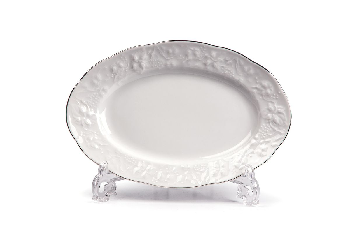 Блюдо овальное, 24 см, цвет: белый с платиной6918240019Блюдо овальное 24 см Материал: фарфор: цвет: белый с платинойСерия: VENDANGE