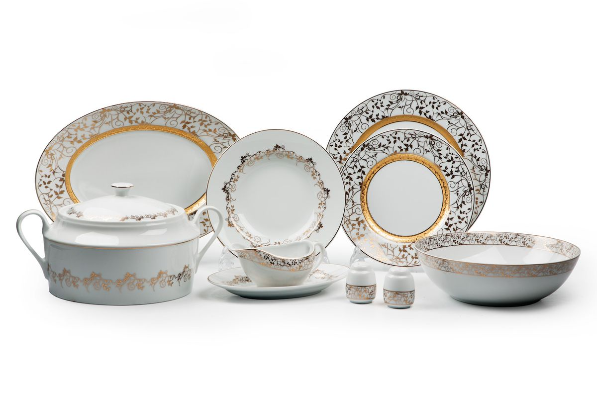 Mimosa Lierre Or 947, сервиз столовый 25 предметов, цвет: белый с золотом539825947Супница 3,5 л , глубокая тарелка 22 см 6 штук , тарелка 27см 6 штук , десертная тарелка 21см 6 штук , солонка, перечница, Блюдо овальное 24 см, Блюдо овальное 35 см , салатник 25см, соусник 230мл.Элегантная посуда класса люкс теперь на вашем столе каждый день. Сделанные из высококачественного материала с использованием новейших технологий, предметы сервировки Tunisie Porcelaine невероятно прочны и прекрасно подходят для повседневного использования. Материал: фарфор: цвет: белый с золотомСерия: MIMOSA