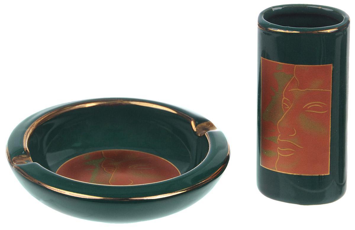 """Набор """"Улыбка"""", состоящий из пепельницы и подставки для зажигалки, сочетает в себе изысканный дизайн с максимальной функциональностью. Пепельница и подставка выполнены из керамики и декорированы изображением лица с улыбкой. Пепельница имеет два специальных углубления для сигарет. Набор """"Улыбка"""" - отличный вариант подарка для ваших близких и друзей. Диаметр пепельницы: 8,5 см. Высота пепельницы: 2 см. Размер подставки: 7 см х 3,3 см х 2,3 см."""