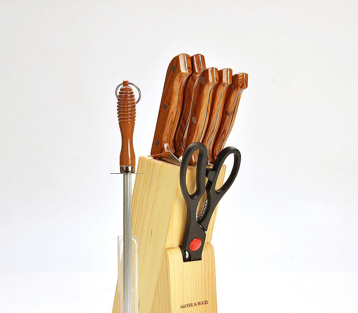 Замечательный набор ножей из высококачественной нержавеющей стали станет  для вас отличным помощником при нарезке овощей, фруктов и  мяса. Специальный дизайн ручки из пластика обеспечивает безопасную работу и  комфортное положение в руке. Подставка для ножей из дерева, которая входит в набор, сэкономит место на  рабочем столе. В наборе 6 предметов: 5 ножей (длина лезвий 15,2 см, 17,8 см, 13,3 см, 11,4 см, 8,9  см), подставка, ножницы и точилка.