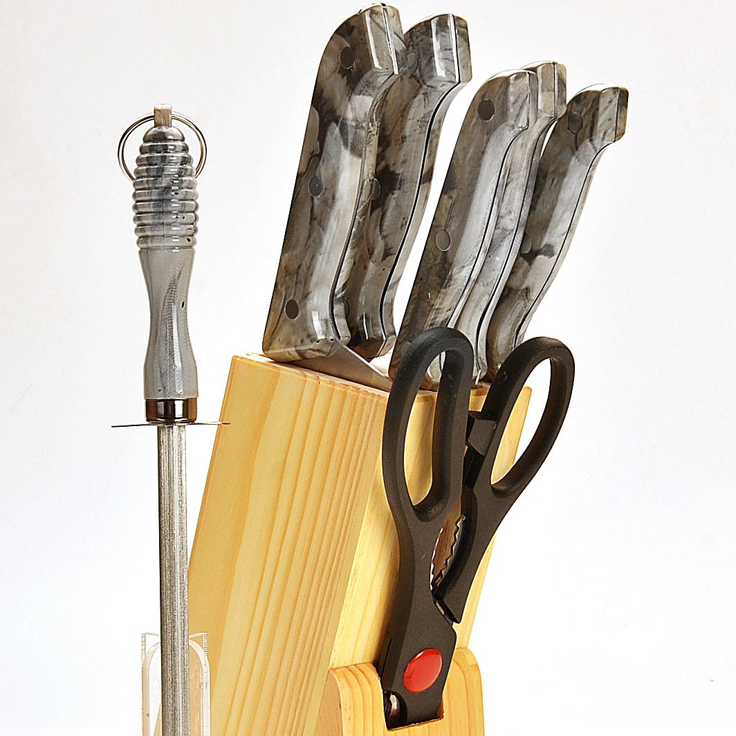 396 Ножи МВ 8пр мрамор/руч с мусатом (х12) светлый мрамор396Набор ножей мрамор/руч,нерж.сталь.8 предметов:5 ножей(15,2см,17,8см,13,3см,11,4 см,8,9 см),ножницы(21,6 см),точилка 19 см,деревянная подставкаРазмер упаковки:14,7х7х33,7смвес :1,06 кгЗамечательный набор ножей из высококачественной нержавеющей стали станет для Вас отличным помощником при нарезке овощей,фруктов и мяса.Специальный дизайн ручки из пластика(рисунок Мрамор) обеспечивает безопасную работу и комфортное положение в руке.Подставка для ножей из дерева,которая входит в набор,сэкономит место на рабочем столе,.Готовьте с удовольствием.