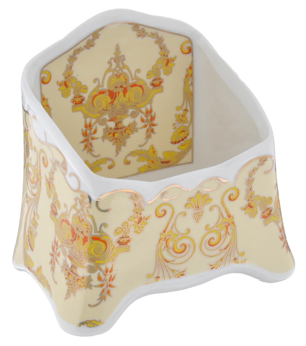 Подставка сервировочная для чайных пакетиков Elan Gallery Узоры, цвет: белый, желтый, золотистый, 10,5 х 7 х 10,5 см503967Сервировочная подставка для чайных пакетиков Elan Gallery Узоры, изготовленная из высококачественной керамики, порадует вас оригинальностью и дизайном. Изделие декорировано цветочными узорами и имеет изысканный внешний вид.Такая подставка, несомненно, понравится любой хозяйке и украсит интерьер любой кухни!