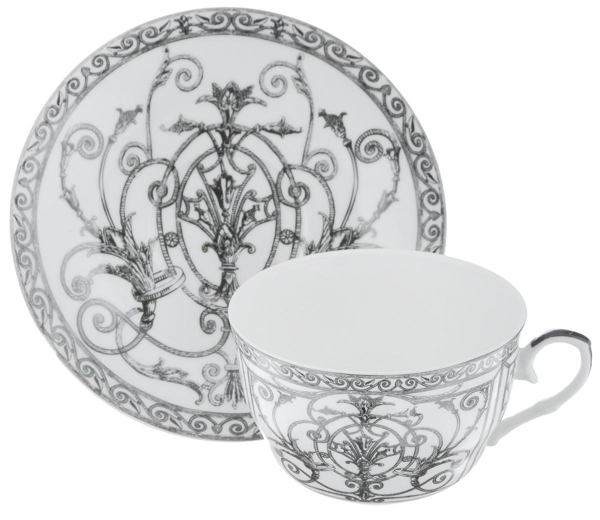 Чайная пара LarangE Ампир, цвет: белый, серый, 2 предмета586-337Чайная пара LarangE Ампир состоит из чашки и блюдца,изготовленных из фарфора. Предметы набора оформленыизящным рисунком.Чайная пара LarangE Ампир украсит ваш кухонный стол, а такжестанет замечательным подарком друзьям и близким.Объем чашки: 250 мл.Диаметр чашки по верхнему краю: 9 см.Высота чашки: 6 см.Диаметр блюдца: 14,5 см.