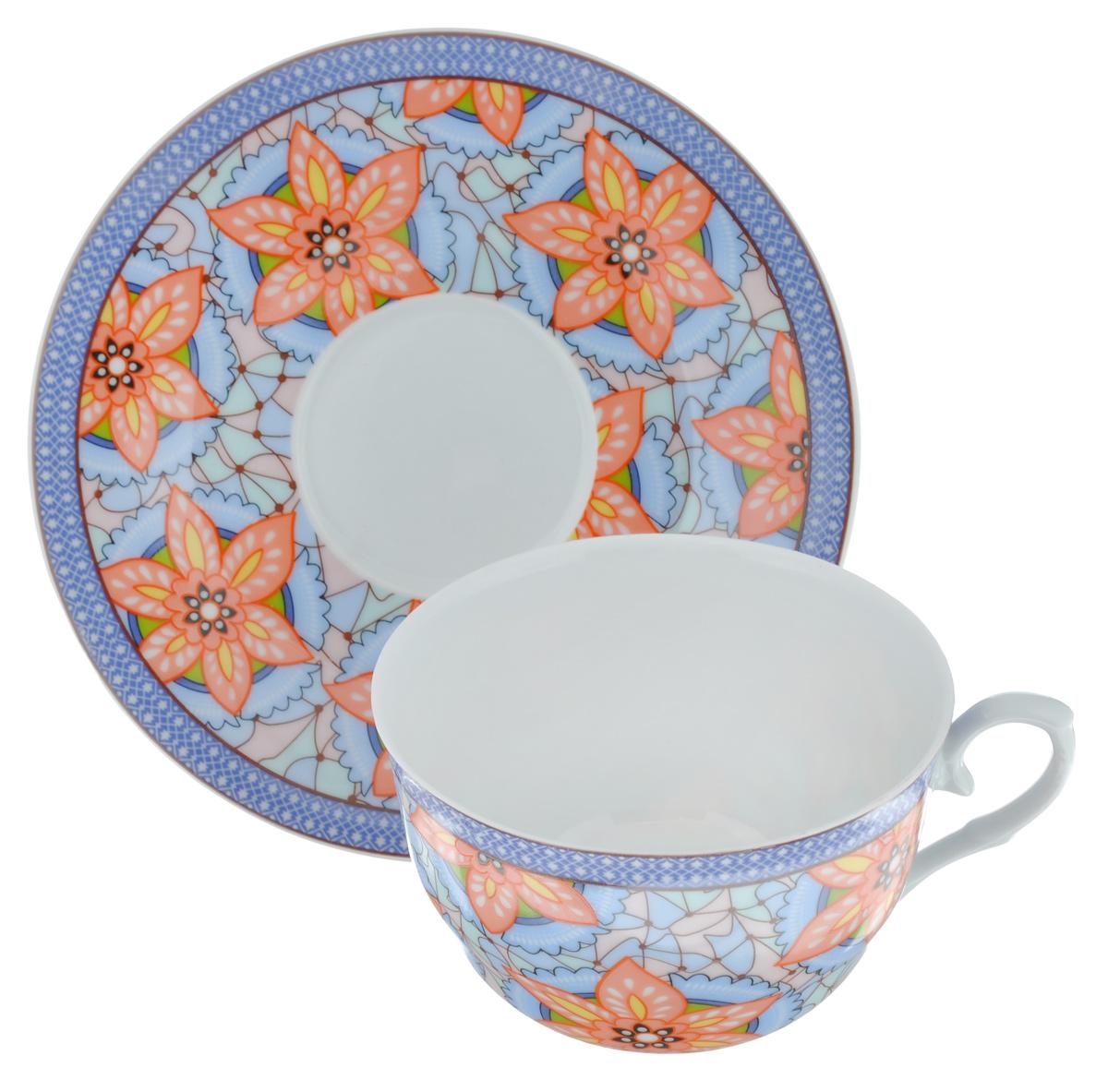 Чайная пара LarangE Витраж, цвет: голубой, персиковый, 2 предмета586-332Чайная пара LarangE Витраж состоит из чашки и блюдца,изготовленных из фарфора. Предметы набора оформленыизящным ярким рисунком.Чайная пара LarangE Витраж украсит ваш кухонный стол, а такжестанет замечательным подарком друзьям и близким.Объем чашки: 250 мл.Диаметр чашки по верхнему краю: 9,5 см.Высота чашки: 6 см.Диаметр блюдца: 15 см.
