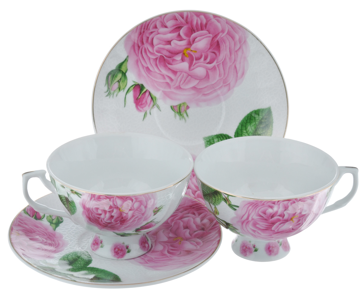 Набор чайный Loraine Роза, 4 предмета21017Чайный набор Loraine Роза состоит из 2 чашек и 2 блюдец. Изделия, выполненные извысококачественного фарфора, имеют элегантныйдизайн и классическую круглую форму.Такой набор прекрасно подойдет как для повседневного использования, так и дляпраздников. Чайный набор Loraine Роза - это не только яркий и полезный подарок для родных иблизких, это также великолепное дизайнерское решение для вашей кухни илистоловой. Объем чашки: 240 мл. Диаметр чашки (по верхнему краю): 10 см. Высота чашки: 6,5 см.Диаметр блюдца (по верхнему краю): 15 см.Высота блюдца: 1,8 см.