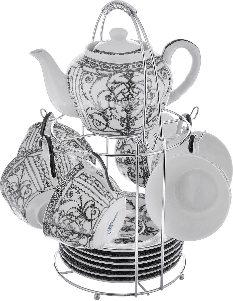 Чайный набор LarangE Ампир, цвет: белый, серый, 14 предметов586-345Чайный набор LarangE Ампир состоит из шести чашек, шести блюдец и заварочного чайника,изготовленных из фарфора. Предметы набора оформленыизящным рисунком и размещаются на металлической подставке.Чайный набор LarangE Ампир украсит ваш кухонный стол, а такжестанет замечательным подарком друзьям и близким.Объем чашки: 250 мл.Диаметр чашки по верхнему краю: 9 см.Высота чашки: 6 см.Диаметр блюдца: 14,5 см.Объем чайника: 600 мл.Диаметр чайника по верхнему краю: 7 см.Высота чайника (без учета крышки): 9 см.Размеры подставки (без учета ручки): 16 см х 20 см х 20 см.