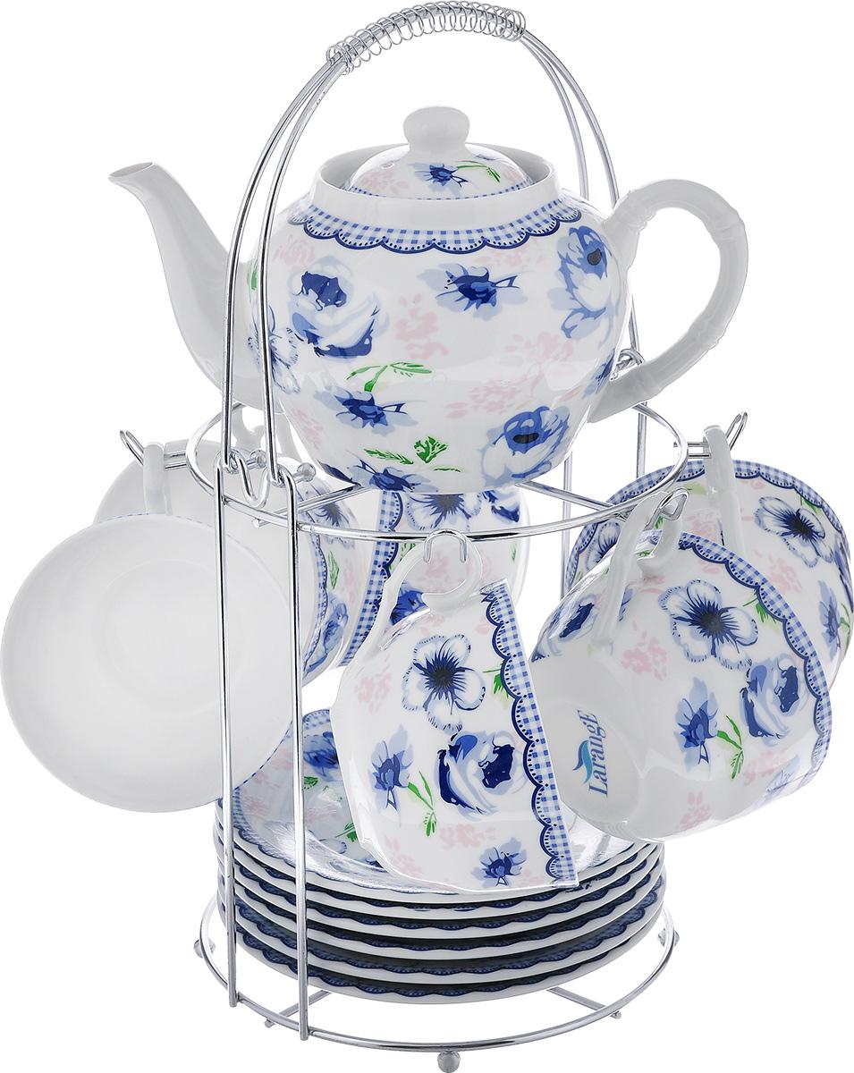 Чайный набор LarangE Кантри, цвет: белый, синий, 14 предметов586-343Чайный набор LarangE Кантри состоит из шести чашек, шести блюдец и заварочного чайника,изготовленных из фарфора. Предметы набора оформленыизящным ярким рисунком и размещаются на металлической подставке.Чайный набор LarangE Кантри украсит ваш кухонный стол, а такжестанет замечательным подарком друзьям и близким.Объем чашки: 250 мл.Диаметр чашки по верхнему краю: 9 см.Высота чашки: 6 см.Диаметр блюдца: 14,5 см.Объем чайника: 600 мл.Диаметр чайника по верхнему краю: 7 см.Высота чайника (без учета крышки): 9 см.Размеры подставки (без учета ручки): 16 см х 20 см х 20 см.