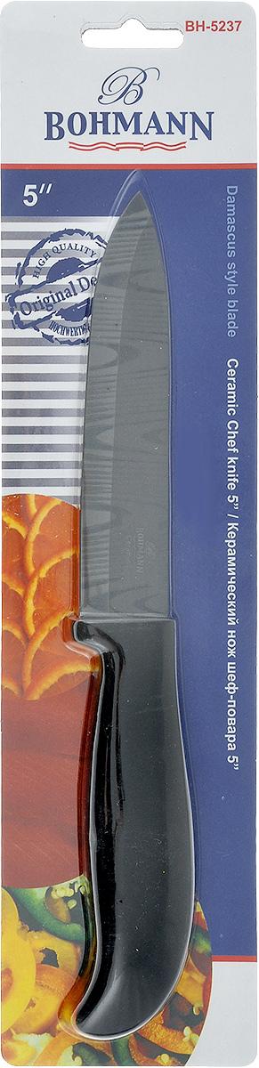 Нож Bohmann, керамический, длина лезвия 12,5 см. 5237BH5237BHНож Bohmann изготовлен из высококачественной керамики черного цвета с дамасским узором. Такойнож отлично подходит для нарезки мяса, измельчения овощей, фруктов. Керамическая поверхность значительно улучшает гигиенические свойства ножа иуменьшает процесс окисления, помогая сохранить полезные свойства продукта. Оночень легкий и абсолютно не ржавеет. Эргономичная рукоятка ножа выполнена изпластика черного цвета. Керамический нож Bohmann предоставит вам все необходимые возможности вуспешном приготовлении пищи. Не резать на стеклянных и металлическихповерхностях. Желательно использовать пластиковые и деревянные разделочные доски.Не рубить кости и замороженные продукты.Можно мыть в посудомоечной машине.Общая длина ножа: 24,5 см.