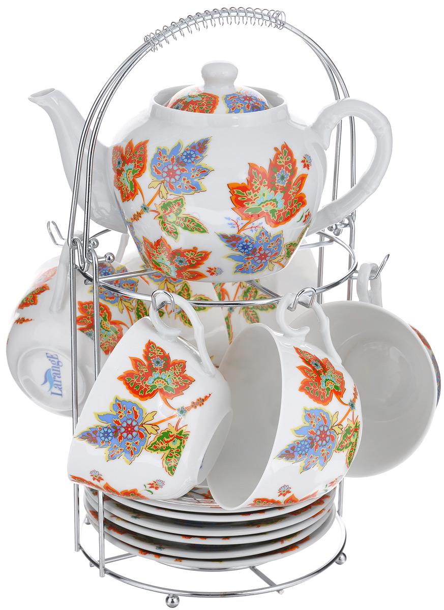 Набор чайный LarangE Восточный микс, 14 предметов586-342Чайный набор LarangE Восточный микс состоит из 6 чашек, 6 блюдец, чайника и подставки. Изделия выполнены из высококачественного фарфора и украшены ярким рисунком.Изящный чайный набор прекрасно оформит стол к чаепитию и станет замечательным подарком для любой хозяйки. Все изделия удобно располагаются на металлической подставке. Можно использовать в микроволновой печи. Объем чашки: 250 мл. Диаметр чашки (по верхнему краю): 9,5 см. Высота чашки: 6,2 см. Диаметр блюдца (по верхнему краю): 15 см. Высота блюдца: 2 см.Объем чайника: 600 мл. Высота чайника (без учета крышки): 9,5 см. Диаметр чайника (по верхнему краю): 7,2 см. Размер подставки: 17 см х 20 см 30 см.