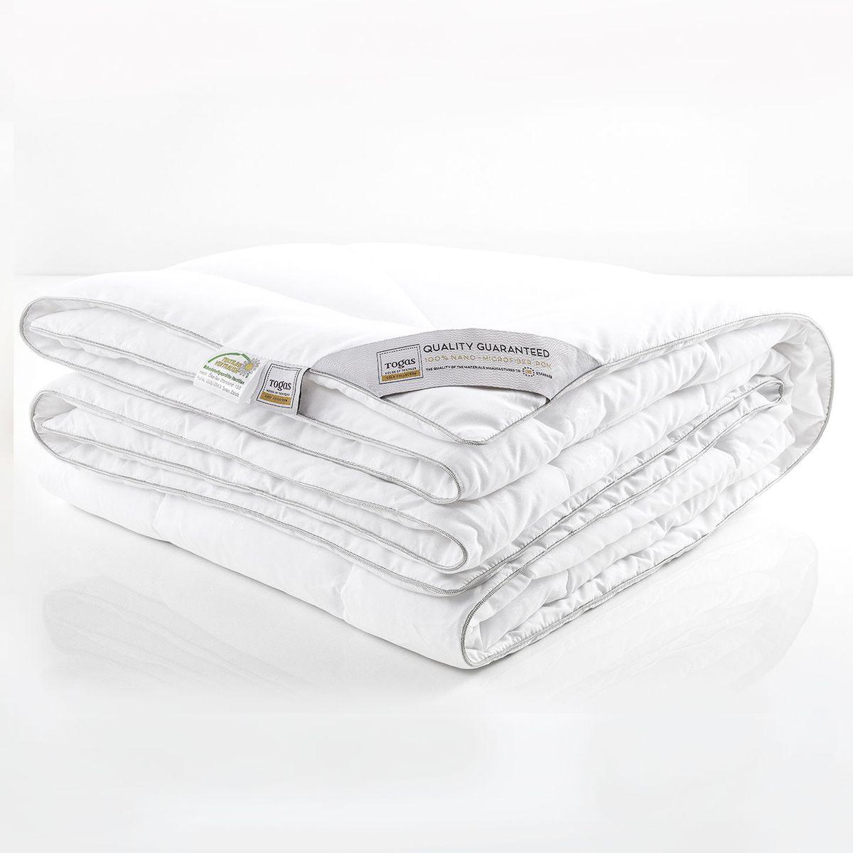 """Одеяло Нано микрофайбер с микрогранулами нано, 220 х 240 см. 20.04.12.001520.04.12.0015Комфортная темпетатура тела во время сна - важная составляющая комфорта. В идеальных условиях тело расслабляется и по-настоящему отдыхает, как результат - Вы просыпаетесь отдохнувшим и бодрым, готовым к новым свершениям. """"Микрофайбер с микрогранулами НАНО"""" - одеяло с """"климатконтролем"""". Оно «подстраивается» под различные температурные условия, регулируя температуру тела во время сна и наполняя Вас ощущением легкости и комфорта"""