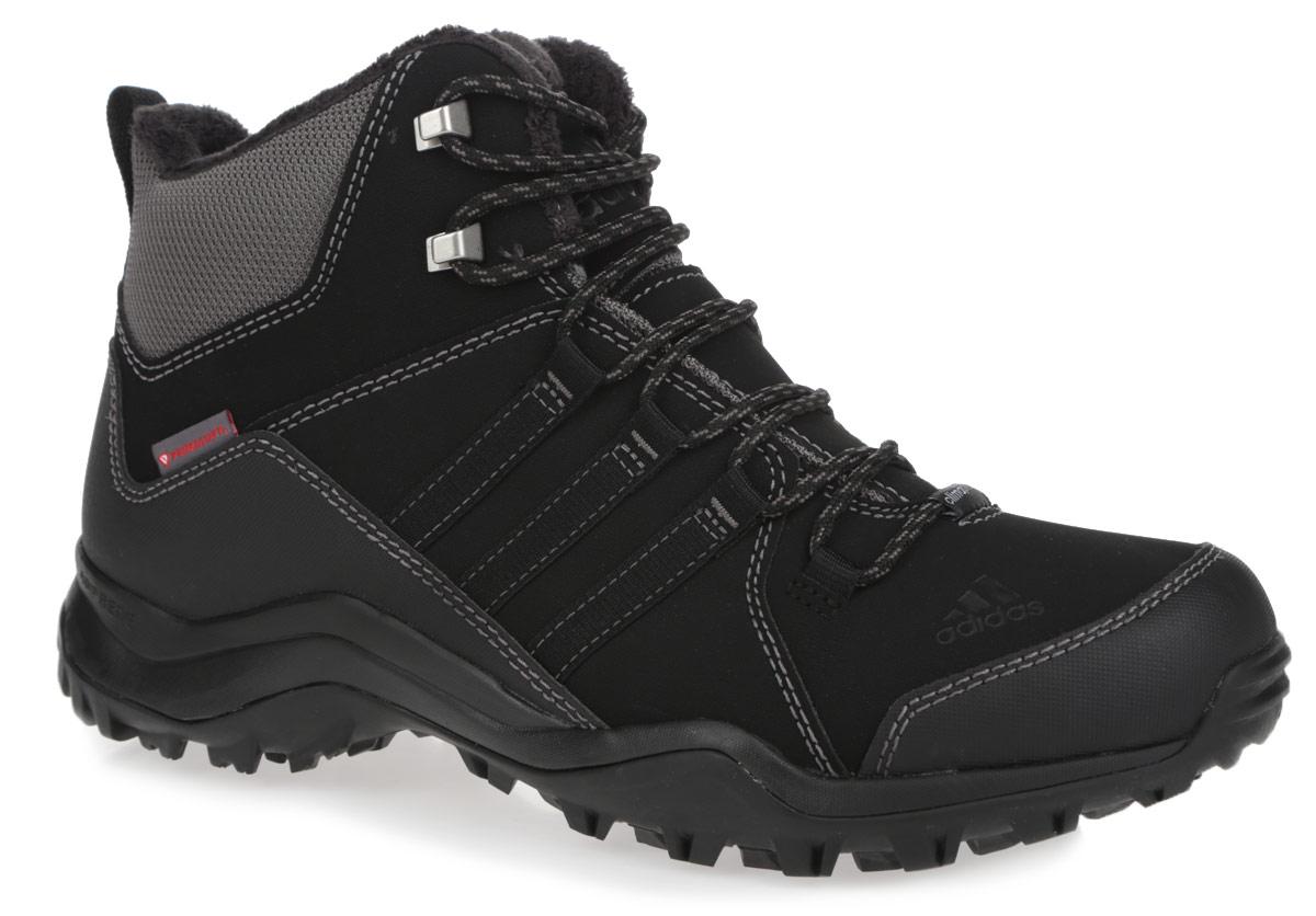 Ботинки мужские трекинговые Adidas Winter Hiker II CP PL, цвет: черный, серый. M18836. Размер 9 (42)M18836Мужские ботинки от Adidas Winter Hiker II CP PL - идеальный вариант для трекинга. Модель выполнена из комбинации прочного сетчатого текстиля, искусственной кожи и других искусственных материалов. Шнуровка надежно фиксирует обувь на ноге. Ботинки с закругленным мыском внутри выполнены из текстиля с верхней частью из искусственного меха. Утеплитель Primaloft предназначен для максимального тепла, защиты от влаги и комфорта. Стелька исполнена из текстиля. По бокам обувь декорирована тремя фирменными полосками, а на заднике и мыске тиснением в виде логотипа бренда. Уникальный дизайн в сочетании с технологией Adiprene в промежуточной части подошвы служит для дополнительной амортизации и смягчения ударных нагрузок. Задняя часть кроссовок дополнена ярлычком для более удобного надевания обуви. Подошва с рельефом Traxion, изготовленная из гибкой резины, обеспечит прочное сцепление с любой поверхностью.