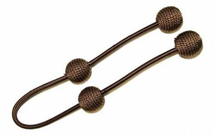 Подхват для штор Talzhou, цвет: коричневый, золотой, длина 63 см, 2 шт7700044_4 коричневый с золотомПодхват для штор Talzhou выполнен из текстиля и имеет внутри гибкую металлическую основу.Подхват - это основной вид фурнитуры в декоре штор, сочетающий в себе не только декоративную функцию, но и практическую - регулировать поток света. Подхваты способны украсить любую комнату.Длина подхвата: 63 см.Комплектация: 2 шт.